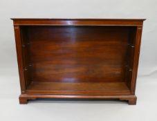 A modern mahogany low bookcase. 137.