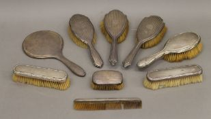 A quantity of various silver backed dressing table sets.