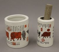 Two Chinese porcelain brush pots. The largest 13 cm high.