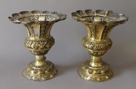 A pair of 19th century gilt copper chalices. 21 cm high.