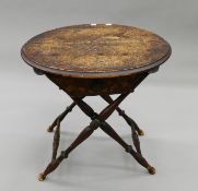 A carved occasional table. 58 cm diameter.