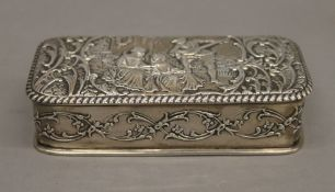 An embossed silver box. 13 cm wide.