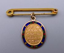 An Eastern unmarked gold enamel decorated pendant on a brooch fitting. 2.25 cm high. 2.