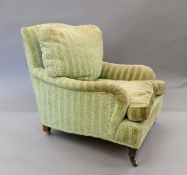 A Victorian Howard style upholstered armchair. 80 cm wide.
