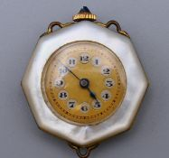 A 1920s mother-of-pearl chatelaine watch, Swiss made movement by Numa, in working order. 3 cm wide.