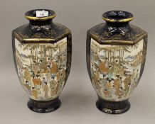 A pair of late 19th/early 20th century Satsuma vases. Each 30.5 cm high.