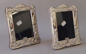 A pair of Art Nouveau style silver photograph frames. 16 x 20 cm.