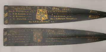Two 19th century four bumps rowing blades, each decorated with the Magdalene College Crest,