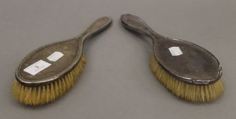 Two silver backed brushes.