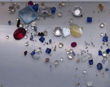 A quantity of assorted gemstones, including diamonds, sapphires, etc.