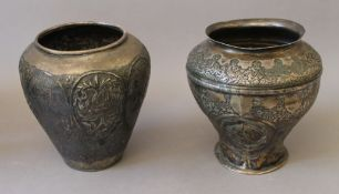 Two early silver Eastern, probably Persian, vases. The largest 17 cm high.