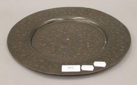 An Islamic copper charger. 30.5 cm diameter.