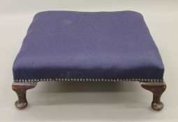 An early 20th century upholstered stool. 51 x 51 cm.