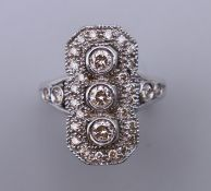 An 18 ct white gold Art Deco style down the finger ring. Ring size O/P.