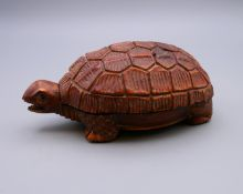 A Japanese wooden box in the form of a tortoise. 11 cm long.