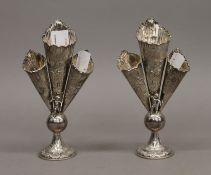 Two silver triple bud vases. 16 cm high.