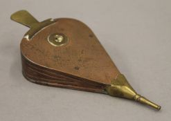 A 19th century copper and brass model set of bellows. 16 cm long.