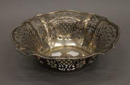 A sterling silver pierced fruit bowl. 25.5 cm diameter.