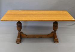 An oak refectory table. 183 cm long x 83 cm wide.