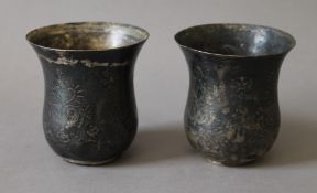 Two early Persian silver beakers. Each 9 cm high.
