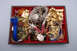 A quantity of costume jewellery and watches.