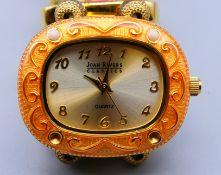 A Joan Rivers enamel wristwatch.