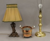 Two table lamps and a twin handled copper vessel. The largest 67 cm high overall.