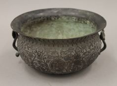 A Chinese patinated censer. 19 cm diameter.