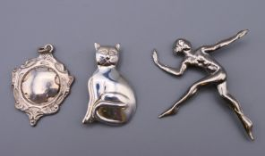 A silver cat brooch, a pendant and another brooch. The former 3.5 cm high.