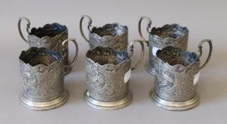 A set of six Russian or Persian silver cup holders. 8.5 cm high.
