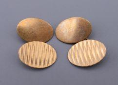 A pair of 9 ct gold cufflinks. 6.1 grammes.