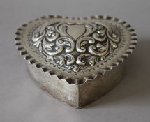 A sterling silver heart shaped box. 12 cm wide. (177.