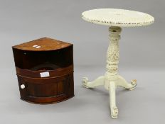 A 19th century mahogany bowfront hanging cupboard and a small carved table. The former 35 cm high.