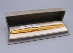 A boxed 18 ct gold Parker pen. 13 cm long. 32.5 grammes total weight.