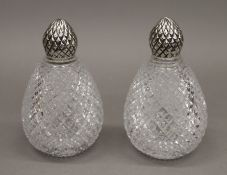 A pair of silver topped and cut-glass scent bottles. 14.5 cm high.