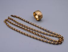A 9 ct gold wedding band and an unmarked gold chain. 29.9 grammes.