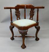 A Georgian style mahogany corner chair. 75 cm wide.
