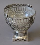 An unmarked silver glass lined basket. 11 cm wide. (157.
