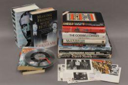 A quantity of books pertaining to Adolf Hitler, photographs, etc.