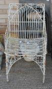 A wire work garden chair.