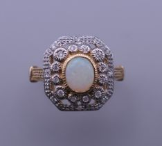 An Art Deco style 9 ct gold, opal and diamond ring. Ring size M/N.