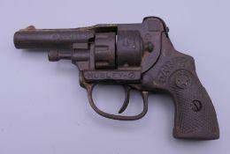 A Hubley cast iron Dandy police 38 revolver cap gun. 14 cm long.