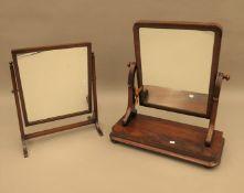 A Victorian mahogany toilet mirror and an Edwardian mahogany toilet mirror. the former 56 cm wide.