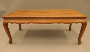 A Chinese hardwood coffee table. 101.5 cm long.