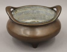 A large Chinese patinated bronze censer, the underside with six character Xuande mark. 23.5 cm wide.