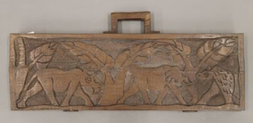 An African carved wooden folding counting tray. 60 cm wide.