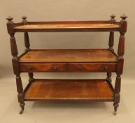 A Victorian mahogany three tier buffet. 117 cm wide.