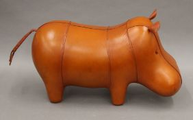 A leather hippo footstool.