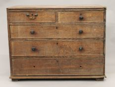 A 19th century oak chest of drawers. 109 cm wide.