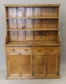 A Georgian pine dresser. 142 cm wide.